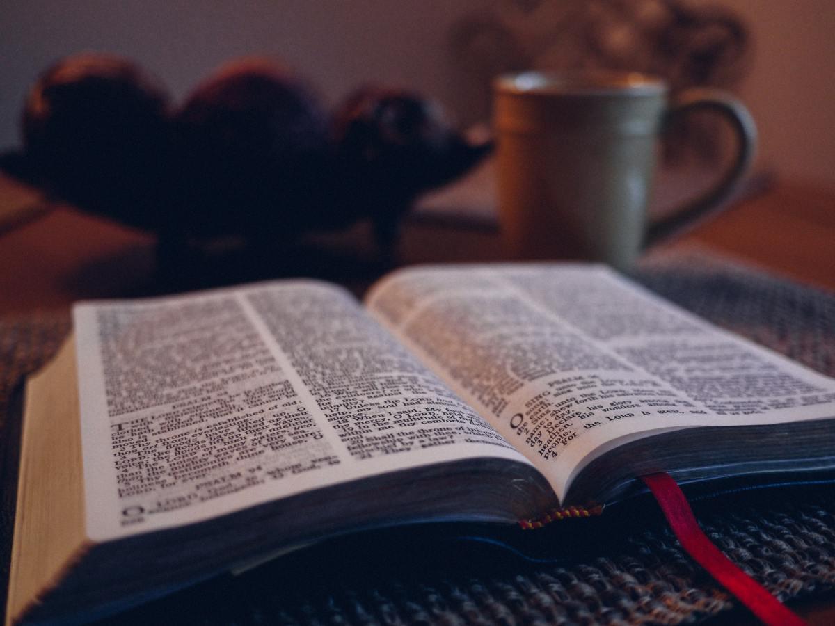 Bible with coffee mug